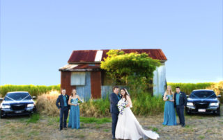 wedding party in front of rusty shed